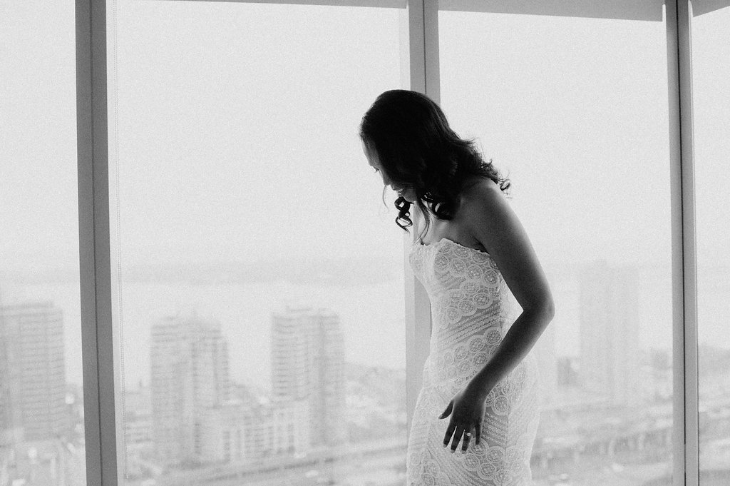 black and white bridal shot with skyline