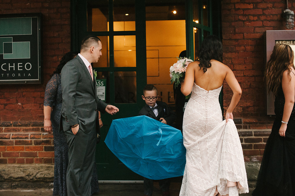 bride and groom blue umbrella