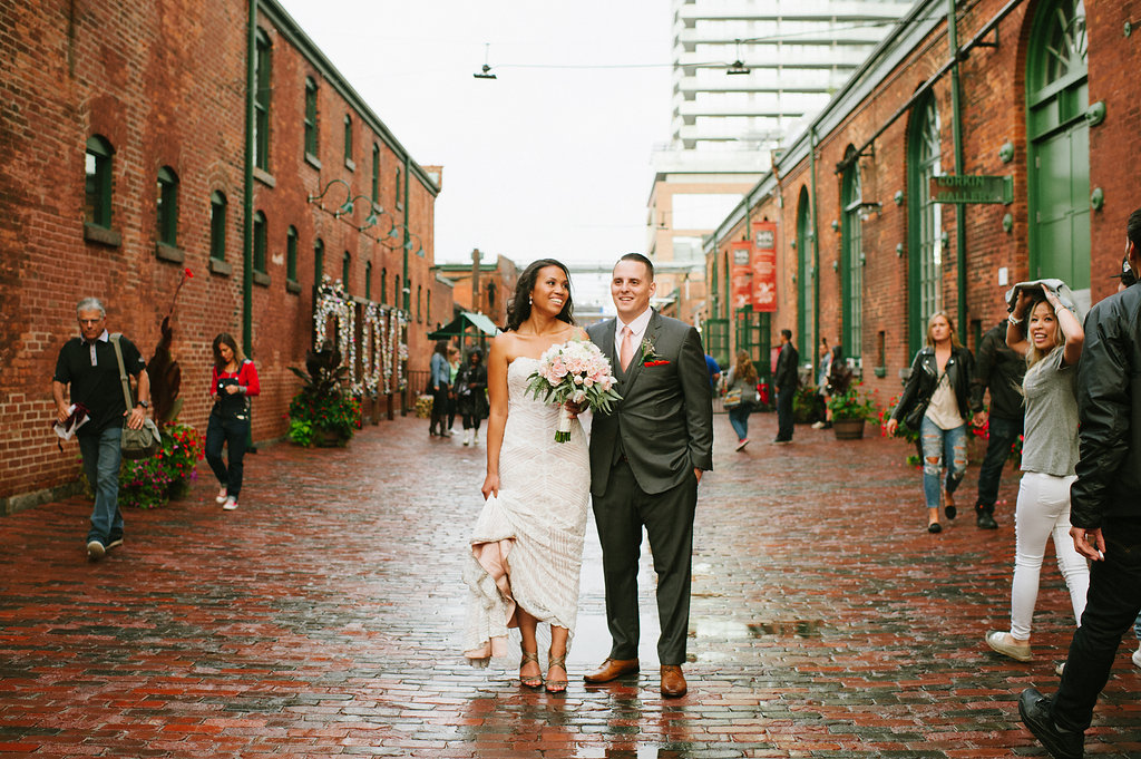 bride and groom on rainy day in Distillery District