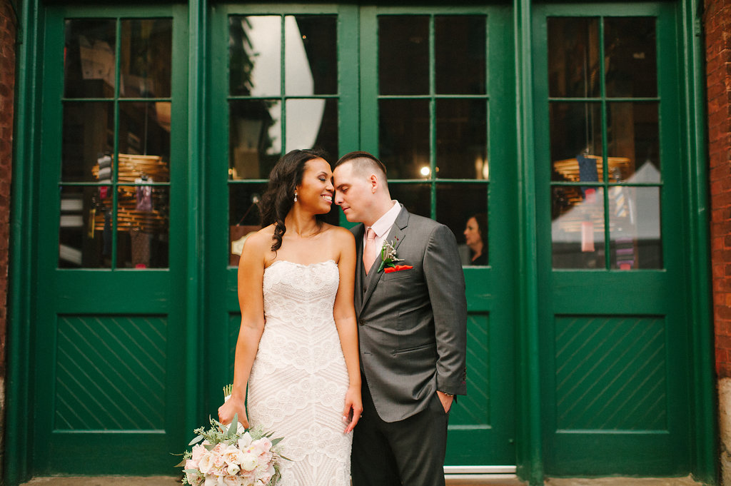 bride and groom and green door