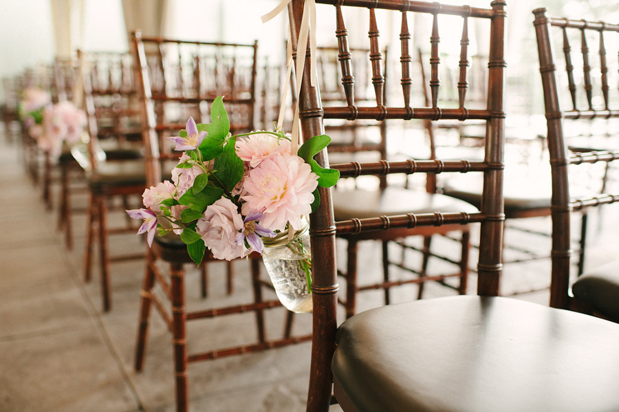 flower details on wedding ceremony chairs