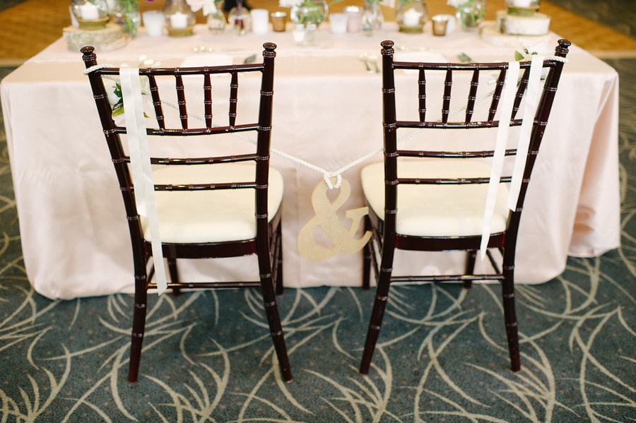 bride and groom's chair at their table