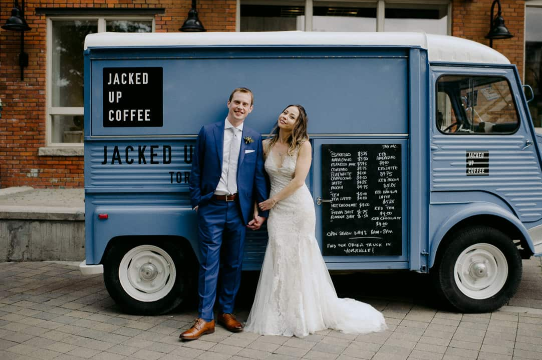 Bride and groom stand in front of Jacked Up Coffee truck in Toronto