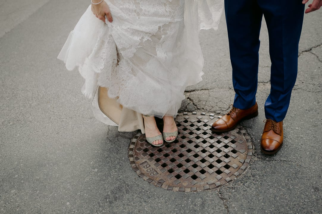 Bride and groom shoes on manhole in Toronto