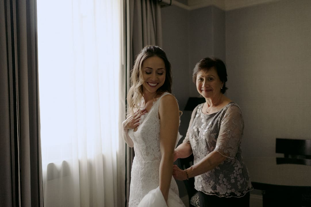 Bride and mother getting ready for wedding at fairmont royal york hotel