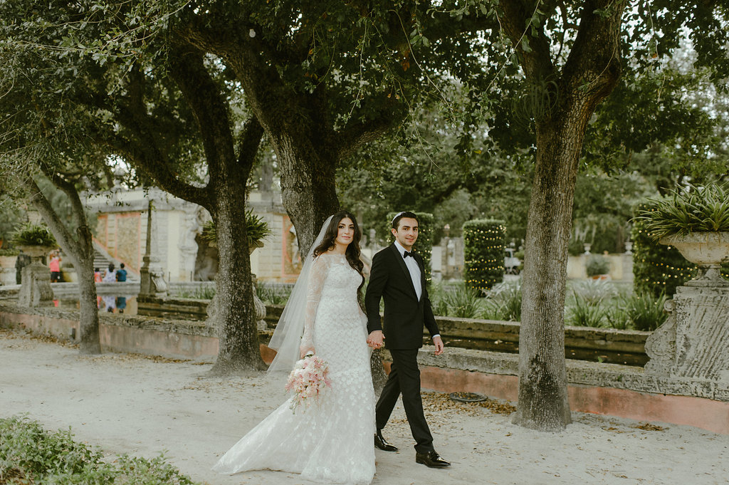 Jewish couple walking in the garden's of Vizcaya in Miami.